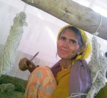 Passion and dedication of a female carpet weaver