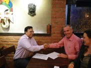 Dharma Life signing contract